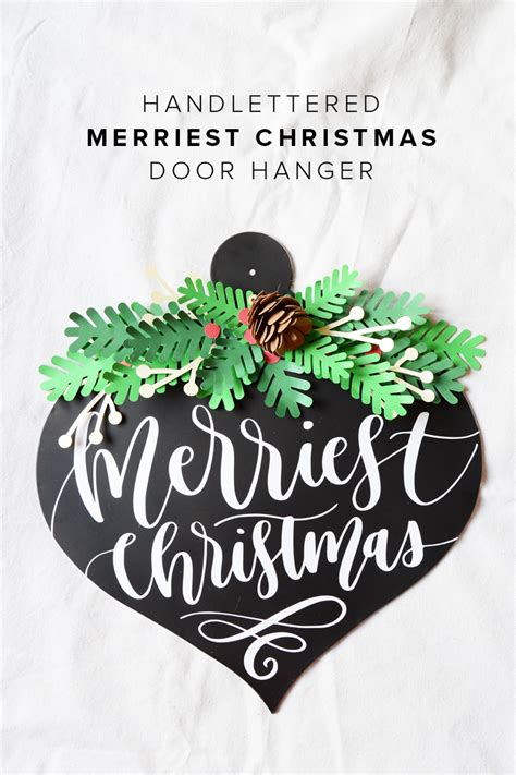 how to make a christmas door hanging on youtube diy merry door hanger vinyl hop and giveaway minted strawberry