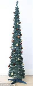real xmas trees asda trees put away that vacuum it s the year of the pop up tree but how easy