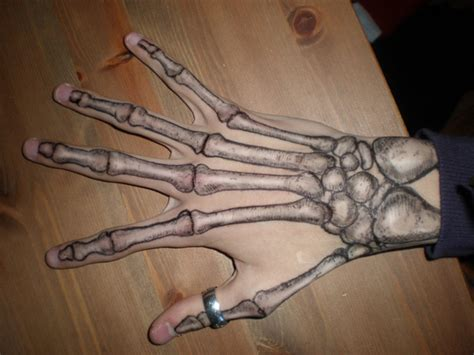 bone hand tattoo skeleton on aphrodite