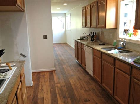 best floors for kitchens flooring with honey oak kitchen cabinets ideas kitchen