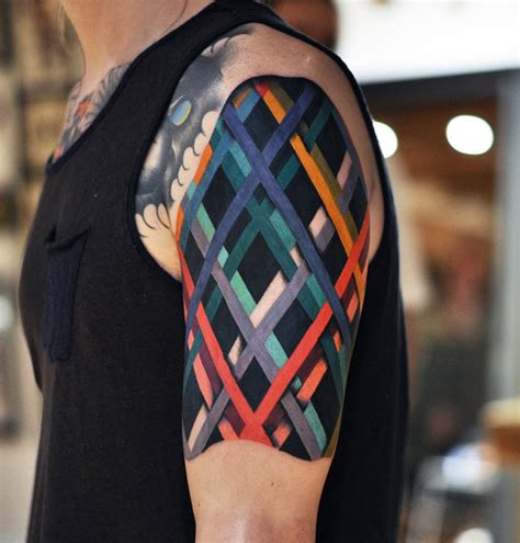 abstract cross tattoo colored lines abstract on guys arm best design ideas