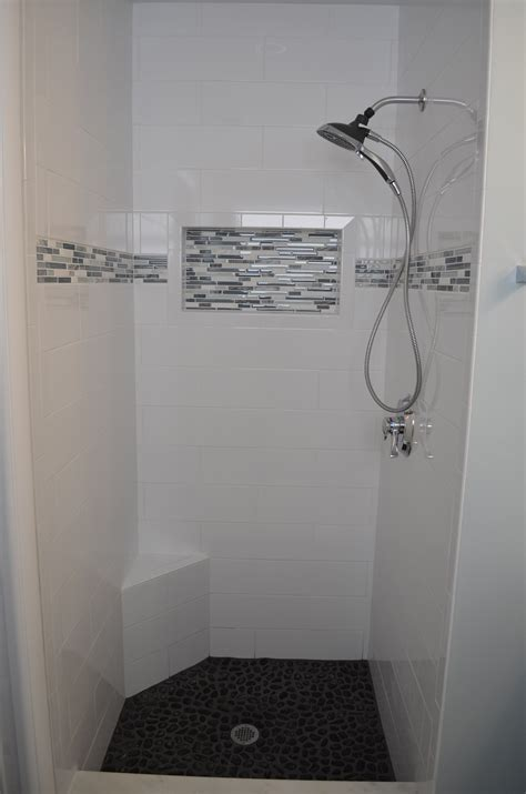 small subway tile small shower design by investcove properties large format