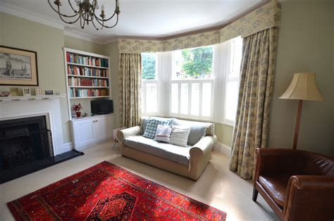 curtains for bay windows in living room curtains with a pelmet in a bay window traditional