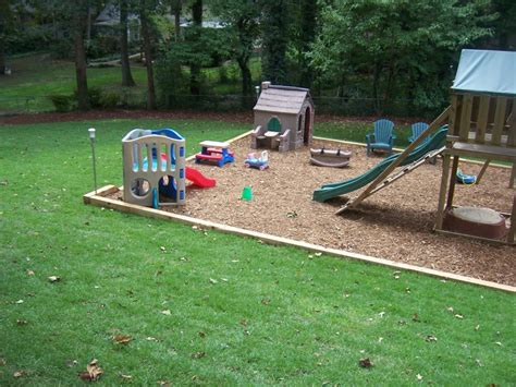 backyard swing set ideas swing set with railroad ties and mulch outdoors
