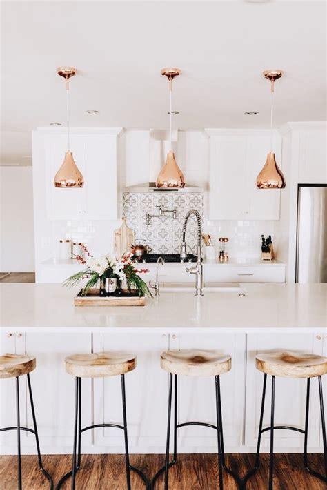 white kitchen white backsplash copper fixtures bar