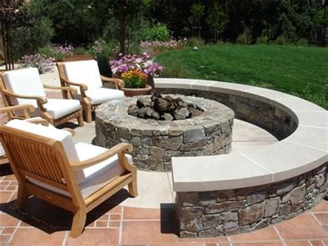 backyard fire pit ideas this stone fire pit offers plenty of seating for outdoor