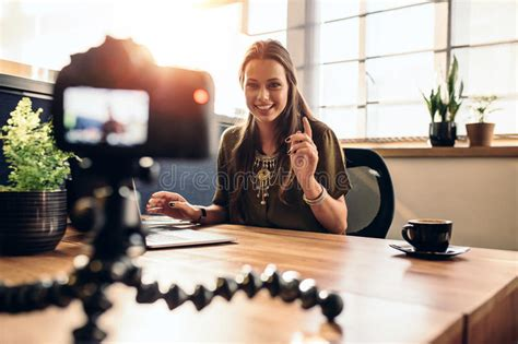 background vlogger young female vlogger recording content for her video blog