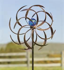 metal wisp wind spinner with glowing glass orb wind