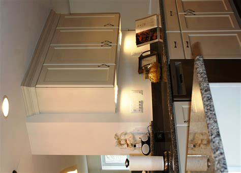 The Redesigned Kitchen Looks Fabulous The Owners Love It Pendant Lights Peninsula