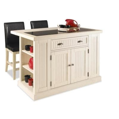 kitchen island home depot home styles nantucket kitchen island in distressed white with black granite inlay and two stools