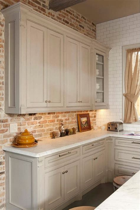 gray kitchen cabinet with brick backsplash whitestone