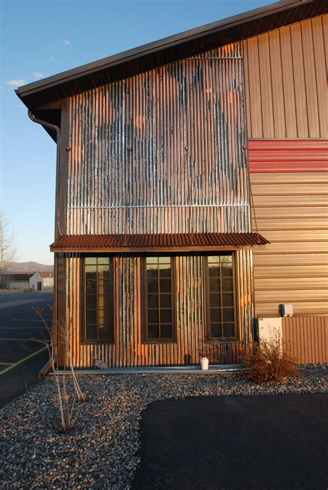 log siding in tin corrugated metal as accent with awning industrial hip