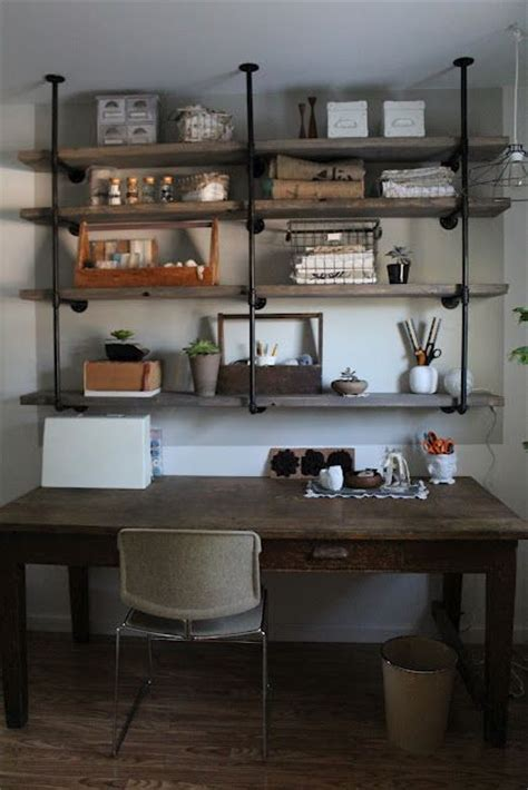 shelves for craft room diy industrial iron wood shelves great tutorial via