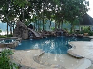 inground pool with waterfall inground swimming pool with waterfalls and slide and beach