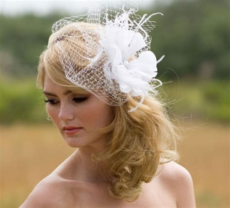 hairstyles for long hair with fascinator wedding hairstyles with fascinators behairstyles com
