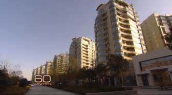 abandoned cities in china this 60 minutes video of china s ghost cities is more surreal than anything we ve ever seen