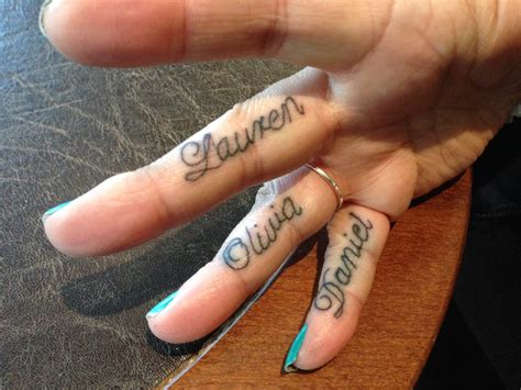 finger name tattoos my children s names d on my fingers tattoos