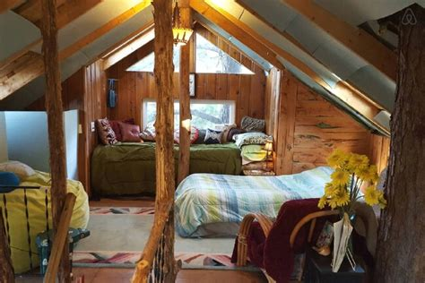 vacation in a tiny house rent this cozy tiny house in the trees for your next