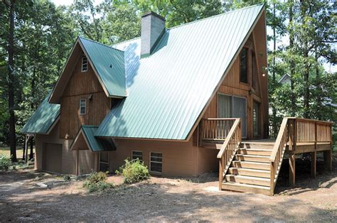 a frame roof green metal roof on a frame home traditional exterior