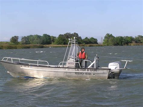 boat driving file man driving survey boat jpg wikimedia commons