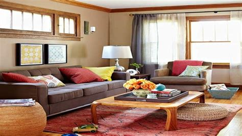 warm colored living rooms red rug beige couch warm color palette home decor decorating with warm colors living room