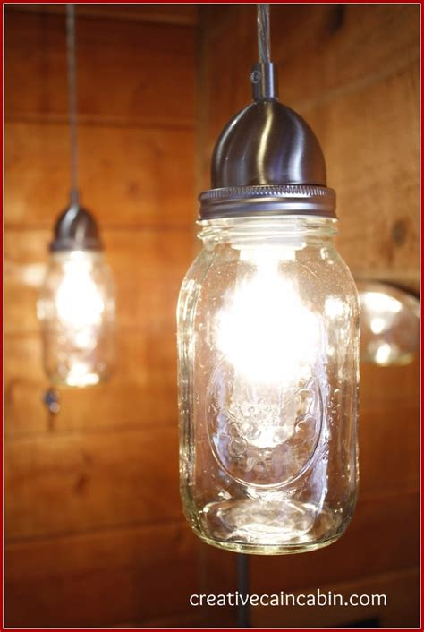 30 Diy Mason Jar Lighting Ideas Sister On A Budget Diy Jar Pendant Lights