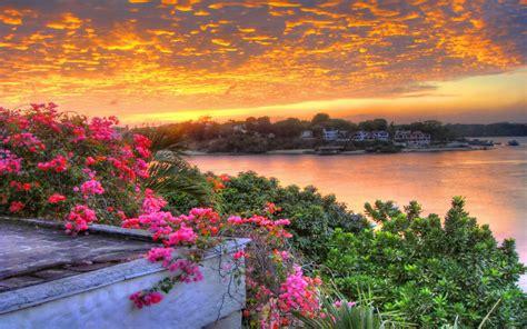 sunrise lake countryside beautiful sky  orange clouds