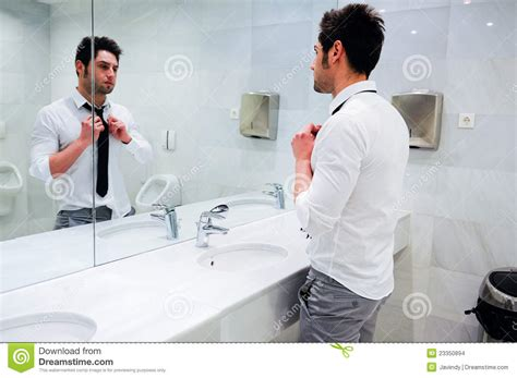 Getting In The Bathroom by Getting Dressed In A Restroom Stock Images Image 23350894