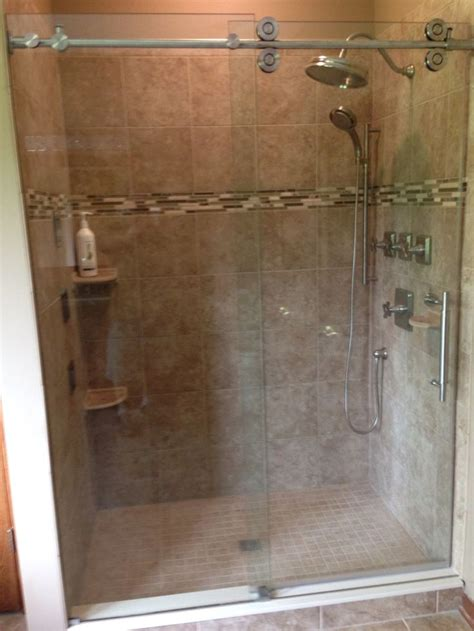 rolling shower door style sliding shower enclosure with exposed roller