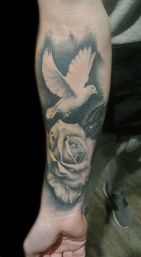 dove with rose tattoo 35 dove tattoos with roses