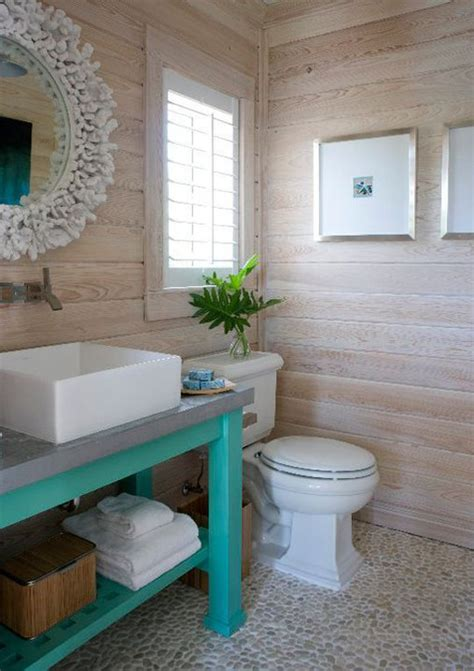 pool bathroom white washed wooden walls pebbled floor coral mirror and