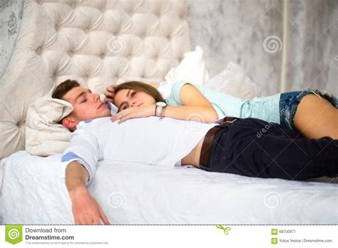 in bed lying on the boy s shoulder stock image image 69700971