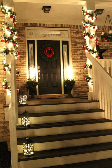christmas front door love the lights in the lanterns
