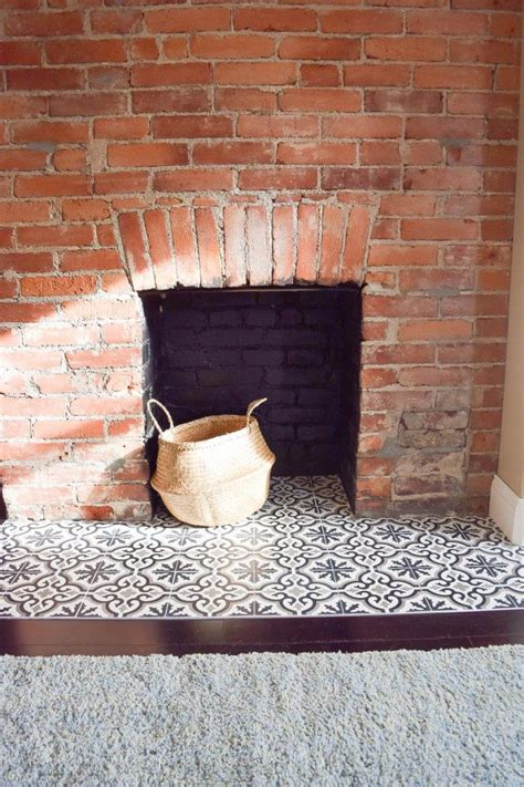 25 best ideas about hearth tiles on fireplace