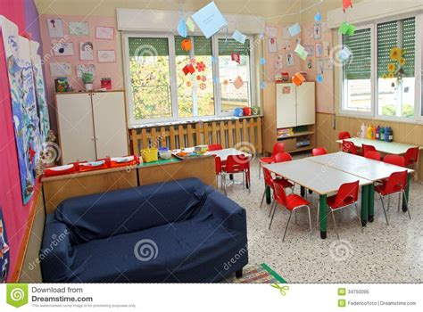 classroom sofa classroom in a kindergarten with tables and chairs and
