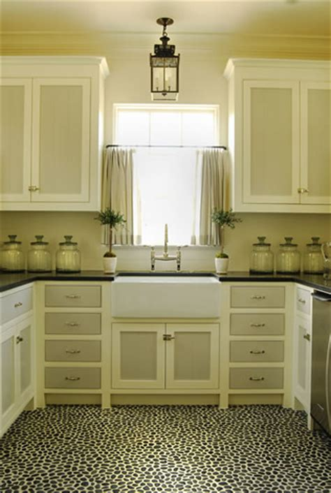 painting kitchen cabinets two different colors kitchen by phoebe howard pebble tile