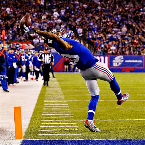 the science of odell beckham jrs incredible onehanded td catch 2014 i img 2fphoto 2f2014 2f1123 2fnfl g objts3 1296x1296 jpg