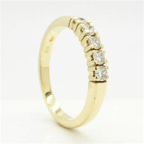14k yellow gold channel ring with 0 25 worth of diamonds