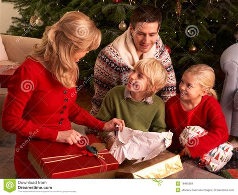 gifts families family opening gifts at home stock images