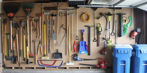 why think small install pegboard on an entire wall of your garage to store organize tools