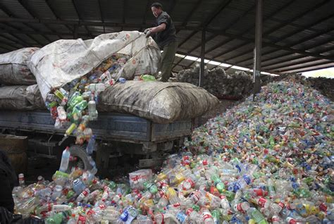 Sunlife Collection Plastic a worker unloads waste plastic bottles at the xiejiacun waste collection market in beijing