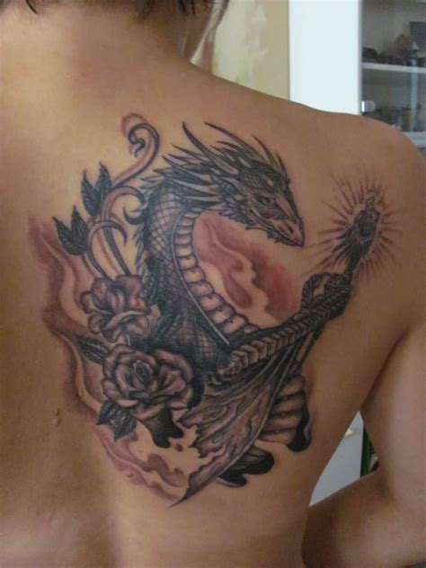 rose and dragon tattoos grey ink flower and on back