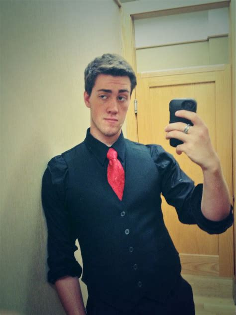 homecoming guy outfits black shirt and vest with a red tie black and red best