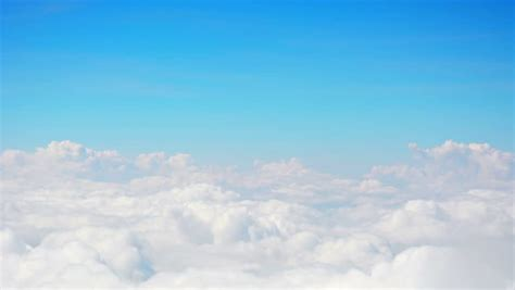 cumulus clouds float across the blue sky timelapse view