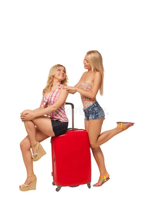 gorgeous red suitcases two girls wearing jeans shorts with big red suitcase stock