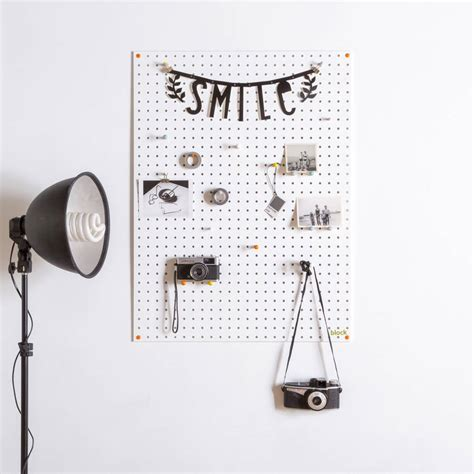 white pegboard with wooden pegs small by block design white pegboard with wooden pegs large by block