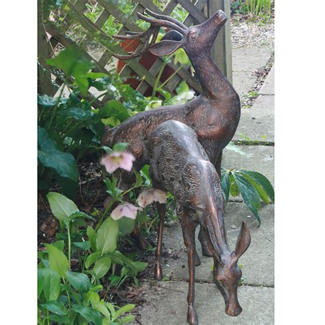 small metal deer garden statues pair bronze stag statues candle and blue