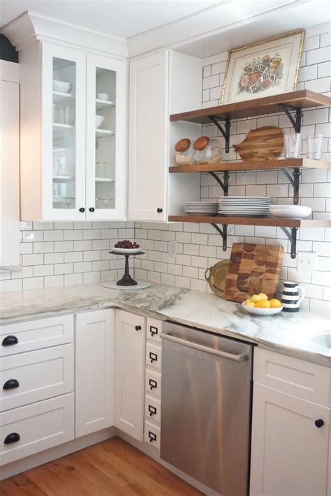 white kitchen cabinets with white marble countertops vintage kitchen remodel white shaker cabinets marble
