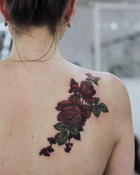 dark rose tattoo on back shoulder roses