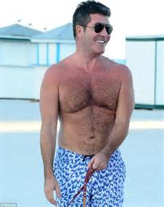 simon cowell shows off physique as he goes for stroll with